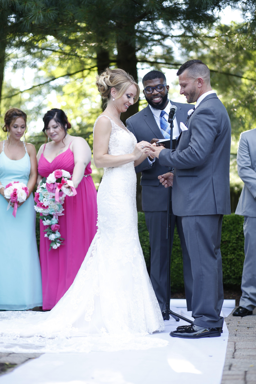 bride giving groom wedding band