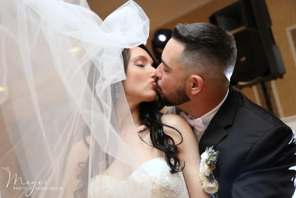 NJ Wedding Photographers wedding veil in atlantis ballroom