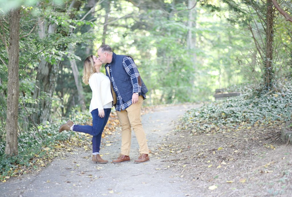 couple kissing on a trail