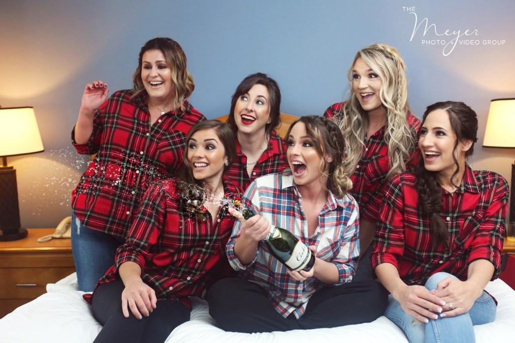 NJ Wedding Photographers - bidesmaids on bed