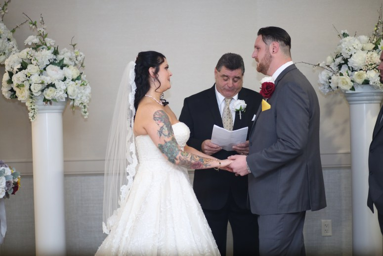 the bride and groom saying their vows