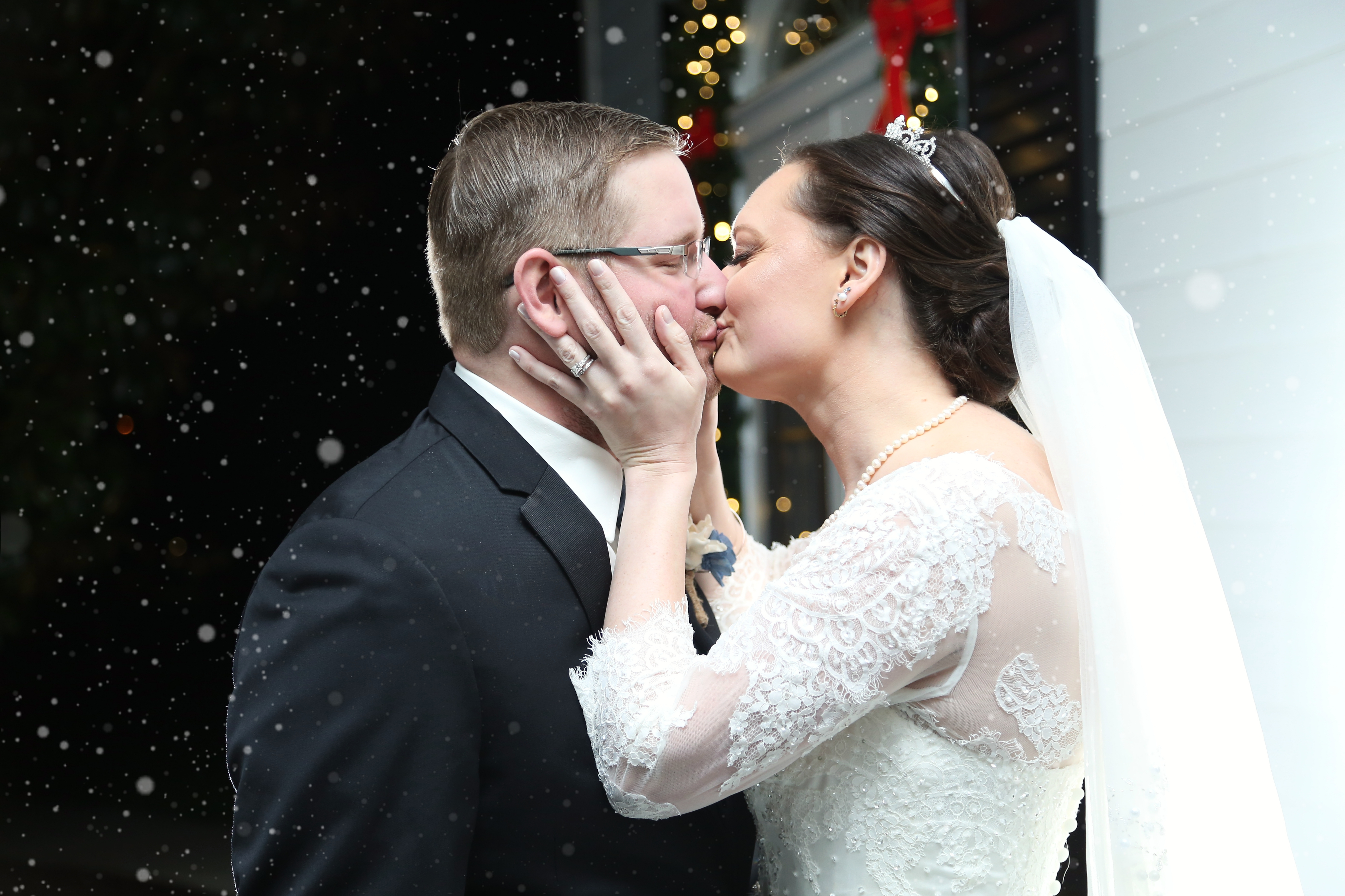 the bride and groom kissing at the carriage house