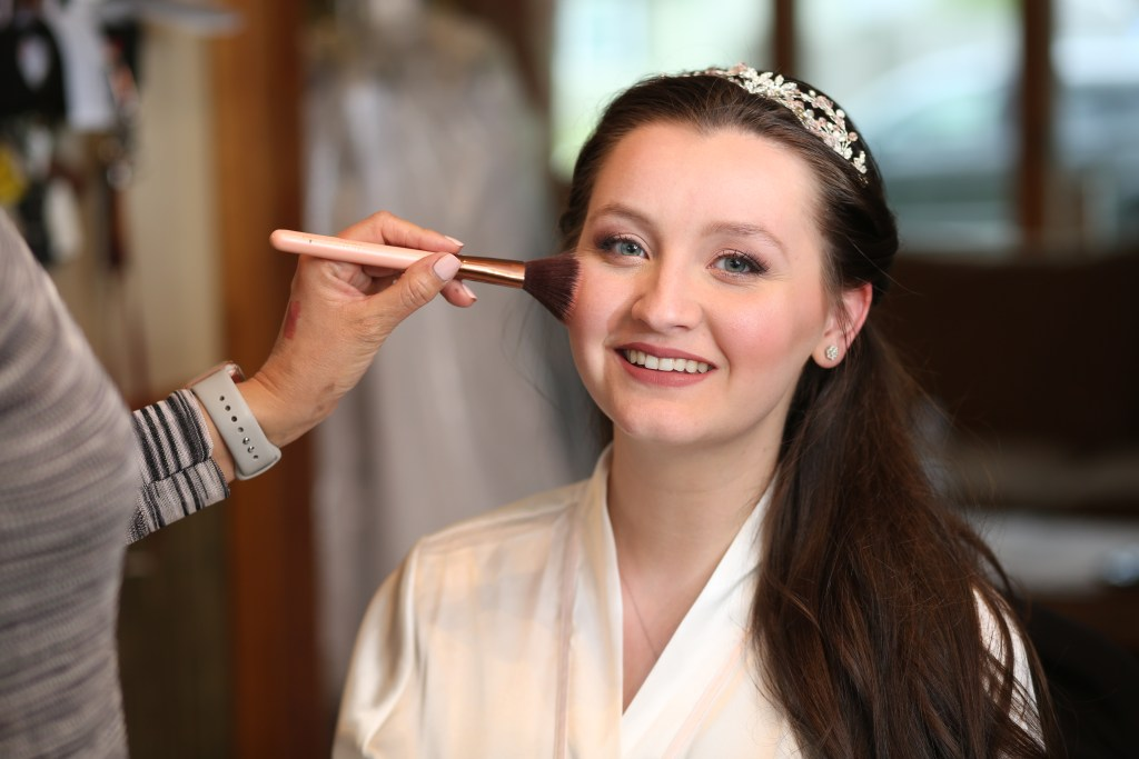 bride having makeup put on at a wedding in NJ