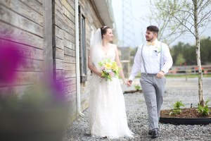 bride and groom holding hands at farm in New Jersey