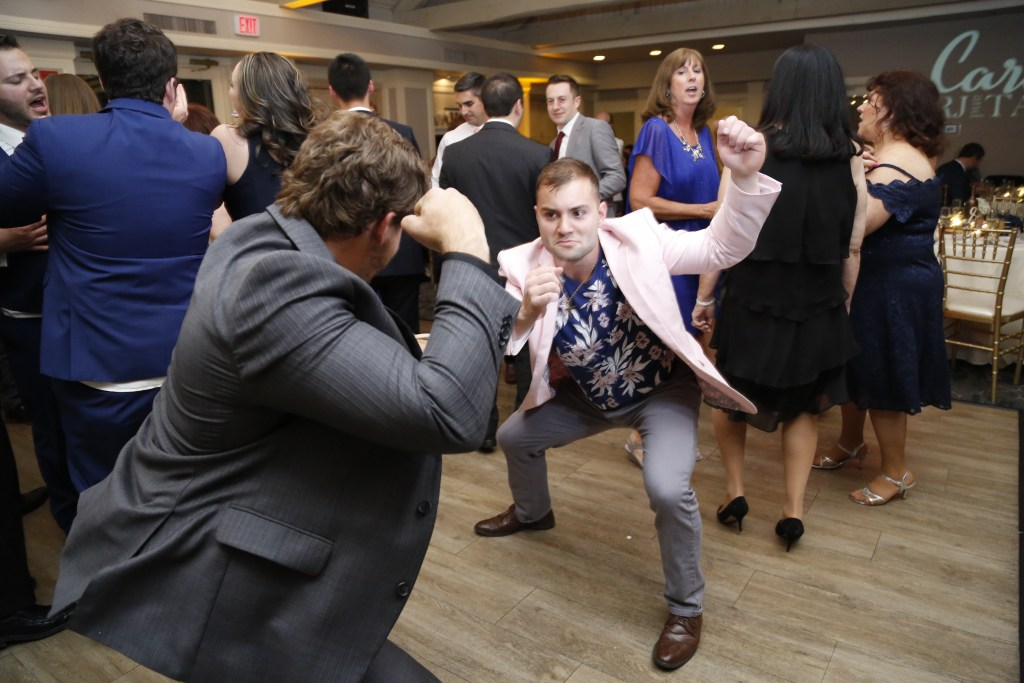 men dancing at wedding in 2019