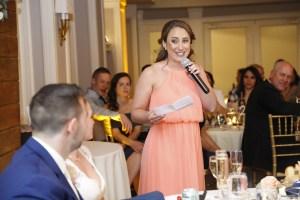 bridesmaid giving speech at wedding