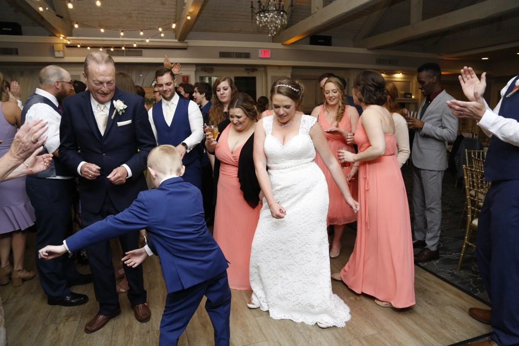 bride dancing with young boy at a wedding in 2019
