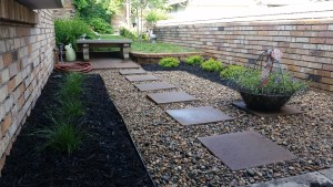 Small garden with stepping stones and gravel