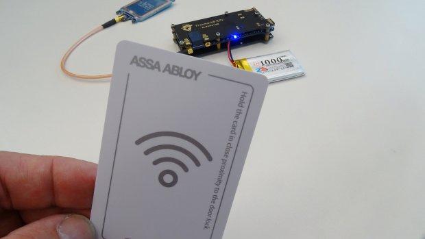 F-Secure researcher Hirvonen shows an Assa AbloyÕs hotel key card in Helsinki