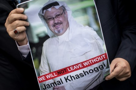 ISTANBUL, TURKEY - OCTOBER 08: A man holds a poster of Saudi journalist Jamal Khashoggi during a protest organized by members of the Turkish-Arabic Media Association at the entrance to Saudi Arabia's consulate on October 8, 2018 in Istanbul, Turkey. Fears are growing over the fate of missing journalist Jamal Khashoggi after Turkish officials said they believe he was murdered inside the Saudi consulate. Saudi consulate officials have said that missing writer and Saudi critic Jamal Khashoggi went missing after leaving the consulate, however the statement directly contradicts other sources including Turkish officials. Jamal Khashoggi a Saudi writer critical of the Kingdom and a contributor to the Washington Post was living in self-imposed exile in the U.S. (Photo by Chris McGrath/Getty Images)