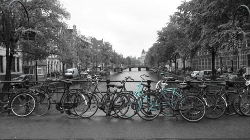 bikes on the canal in amsterdam