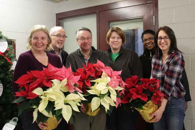 board members with poinsettias
