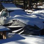 Snow covered rust bucket MGB