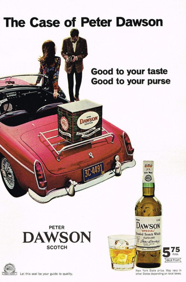 Box of Peter Dawson Scotch on the rack of a 67 MG MGB