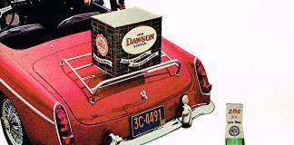 Box of Peter Dawson Scotch on the rack of a 67 MG MGB