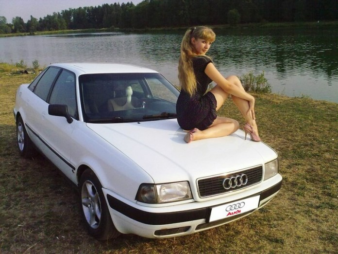 Pretty gal by the lake with her Russian Audi