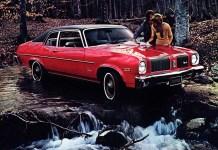 Oldsmobile Omega Hatchback being washed in a stream