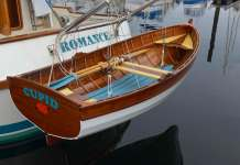 Recently built trawler Romance with an even newer wooden tender