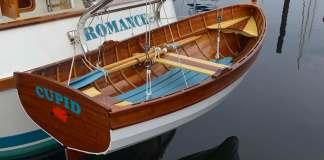 Recently built trawler Romance with an even newer wooden tender