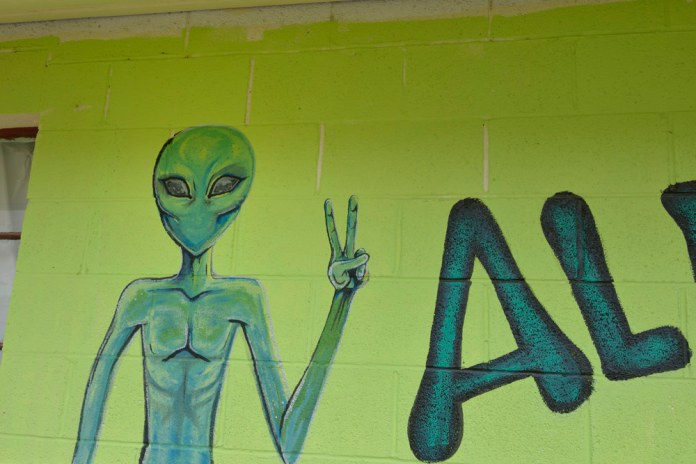 Green alien welcoming visitors in Beatty