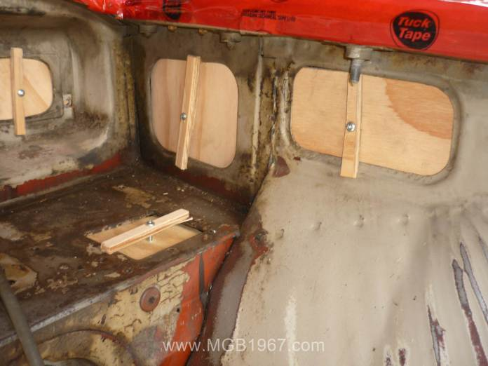 Wooden blocks in the MGB GT engine compartment
