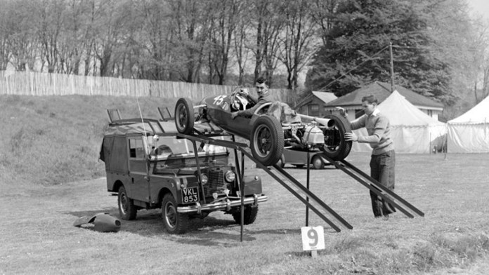 Stuart Lewis Evans and Tony Harris off loading a Cooper 500 from a Land Rover