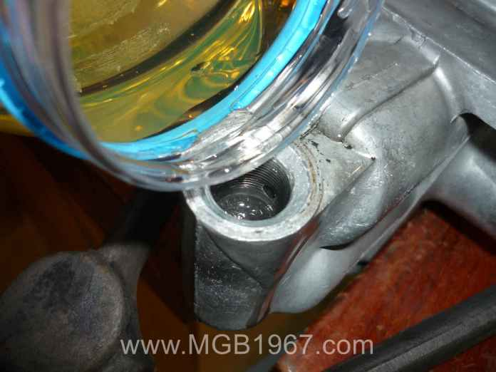 Topping up the MGB Armstrong lever shock
