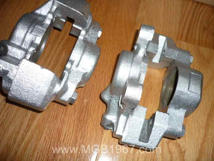 Silver MGB GT front brake calipers