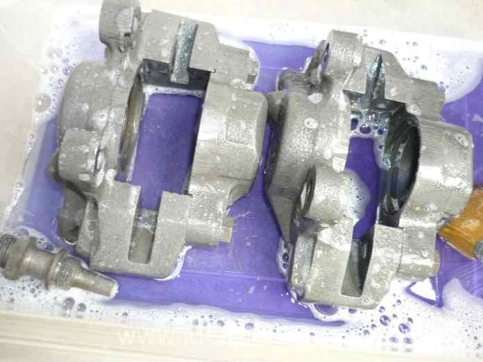 Soaking the MGB GT front brake calipers in POR-15 Metal Prep