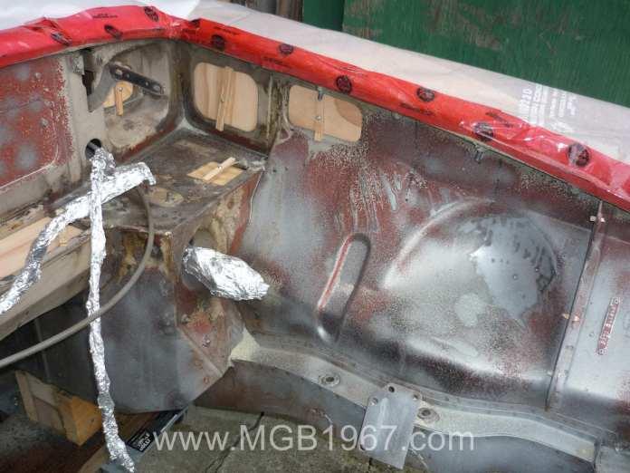 1967 MGB GT engine bay during media blasting