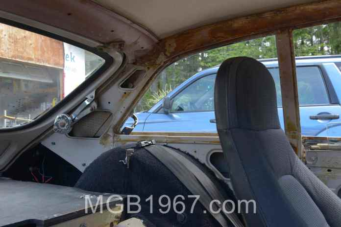 Interior of MGB GT with vinyl trim removed