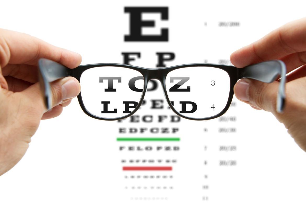 12538332 - looking through the glasses at eye chart