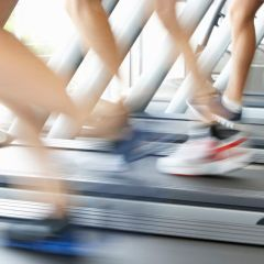 42248822 - close up of 3 runners feet on running machine in gym