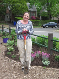 Celia Denton takes a break from replanting Bed 8.