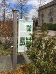 Informational signage in the gardens takes the form of banners, signboards, and individual plant labels