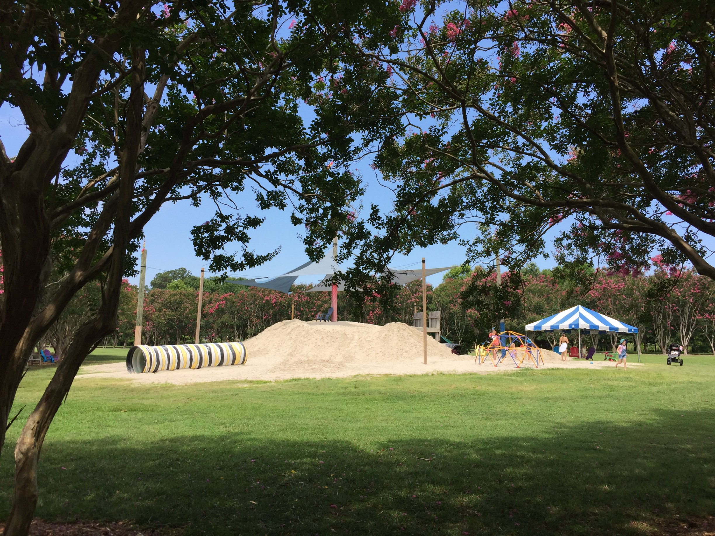 Parents can relax in nearby seating as children enjoy a sandy play area. Photo © 2018 Elaine Mills.