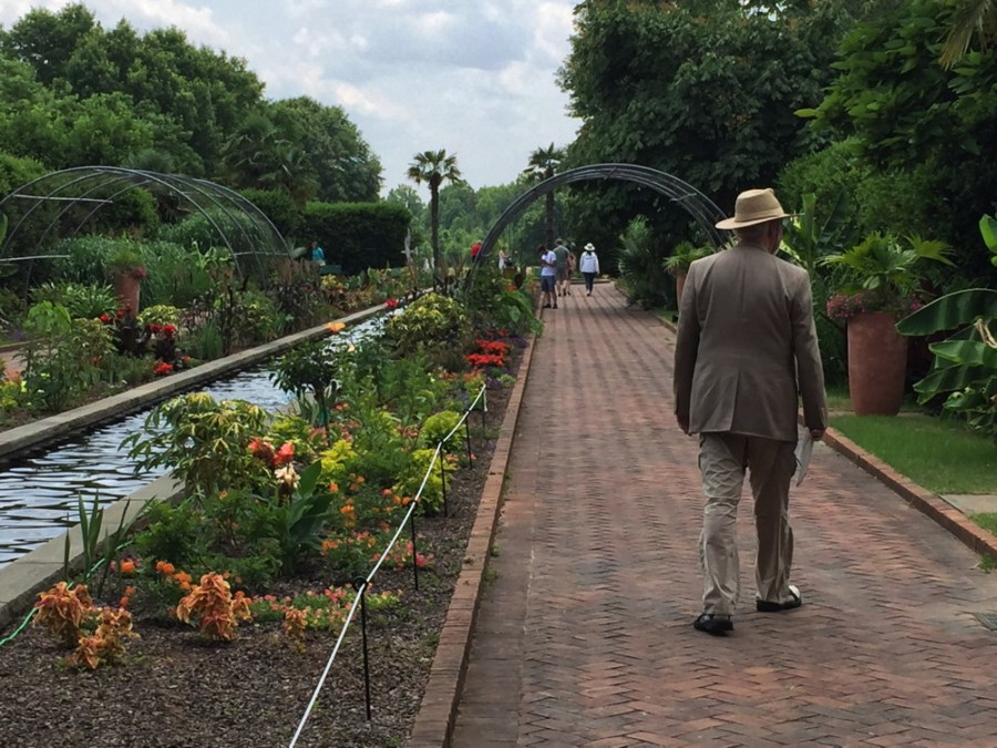 Summer plantings in the 100-yard-long Canal Garden include tropical species and plants with orange and red flowers and foliage.