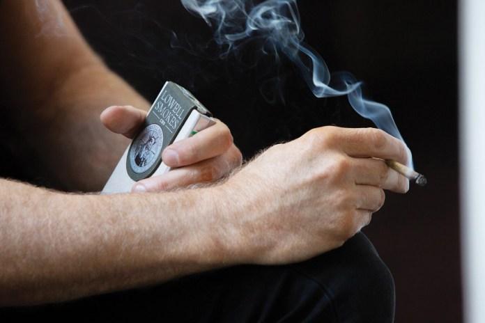Guy Smoking Lowell Smokes preroll