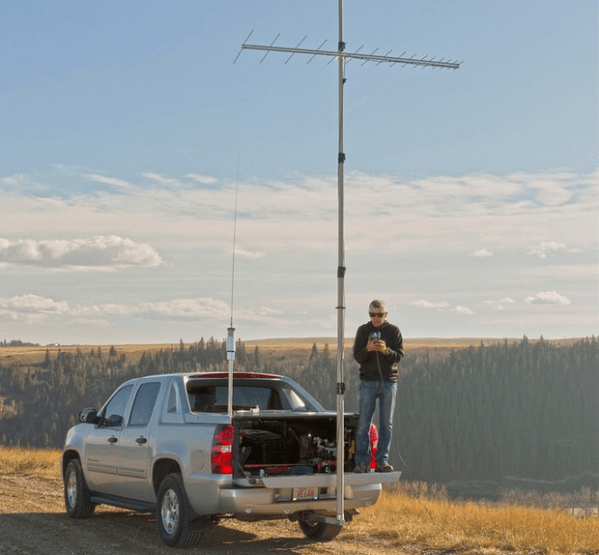 Heavy Duty mast and Hitch Mount supporting an array of antennas for Jerry Clement VE6AB
