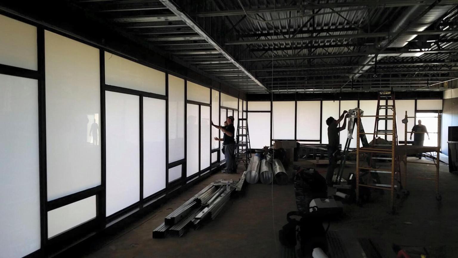 Decorative Window Film Conceals Framework, Walls and Shelving