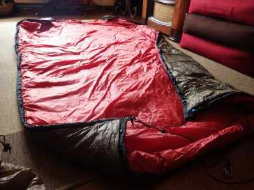 The underquilt spread out with suspension attached.