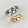 silver/platinum and 18ct gold wedding bands (£1400 sold)
