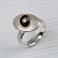 silver, part oxidised and 18ct rose with diamond (£415 sold)