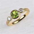 18ct with peridot and diamond (£1150)