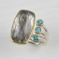 silver and 22ct gold with rutillated quartz and apatite (£795 sold)