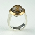 silver and 22ct gold with rutillated quartz (£720 sold)