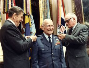 Doolittle is awarded a fourth star, pinned on by President Ronald Reagan (left) and Senator Barry Goldwater (right), April 10, 1985.