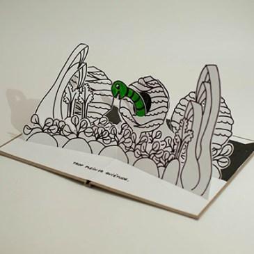 """Projet livre pop-up """"Variation pour un loup et un jardin potager"""", potager avec ver dans un chou, profil"""