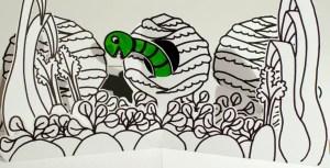 """Livre pop-up """"Variation pour un loup et un jardin potager"""", page 3, ver dans le potager"""