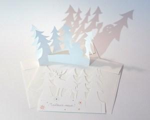 Cartes de vœux en papier découpé motifs cerf et bonhomme de neige avec sapins, lot de 2 cartes